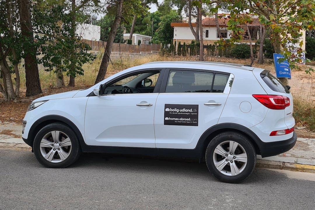Alquiler barato de Kia Sportage con equipamiento GPS cerca de 46183 L'Eliana.