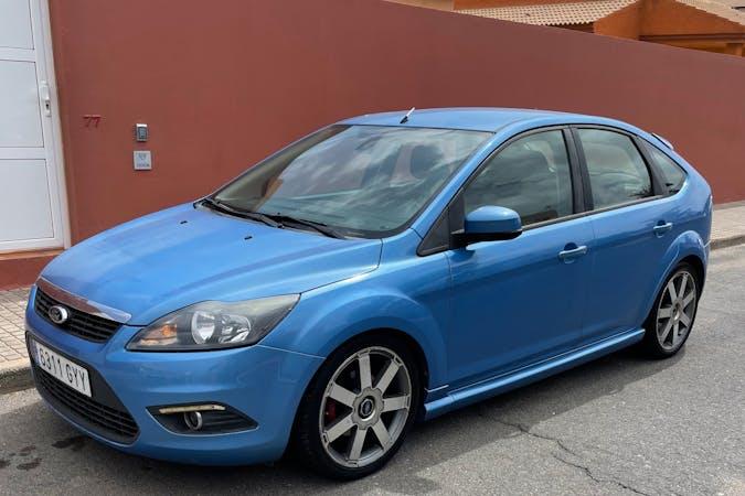 Alquiler barato de Ford Focus con equipamiento GPS cerca de 35660 Corralejo.